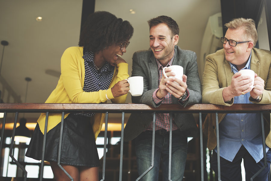 Group Voluntary Benefits - Co Workers Hanging Out Drinking Coffee Together